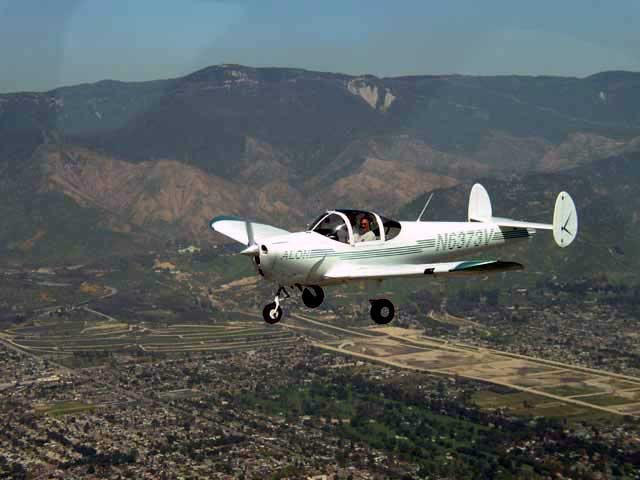 New Aircoupe N6373V Owners Jay Molyneux (right seat) and Larry Fortier (left seat) in their new (purchased in March, 2003) 1965 Alon A2 flying just below the San Bernardino Mountains (Arrowhead) in San Bernardino, CA. Very happy with our new coupe!